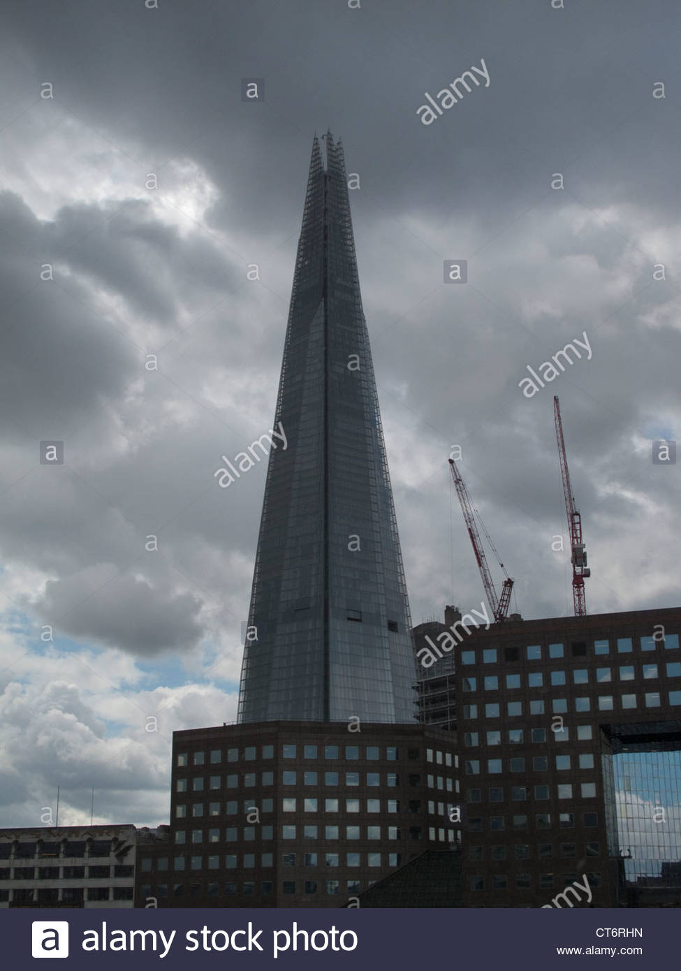 Silhouette of the holy cross on background of storm clouds stock - Storm Clouds Above The Shard London Bridge Tallest Building In Europe Stock Image
