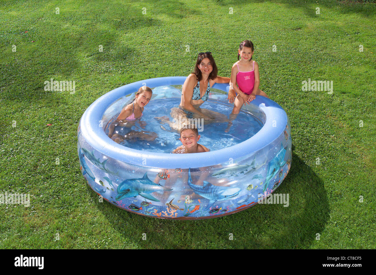 Paddling pool cooling off in the garden stock photo for Garden paddling pools