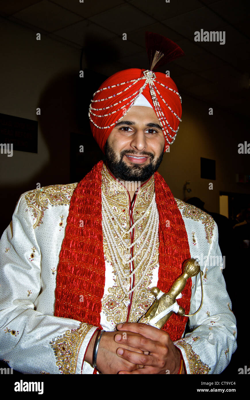 Traditional East Indian Wedding Groom Red Turban Special Pre Ceremony Head Dress Beaded Decorations White Robes Pearls Scarf