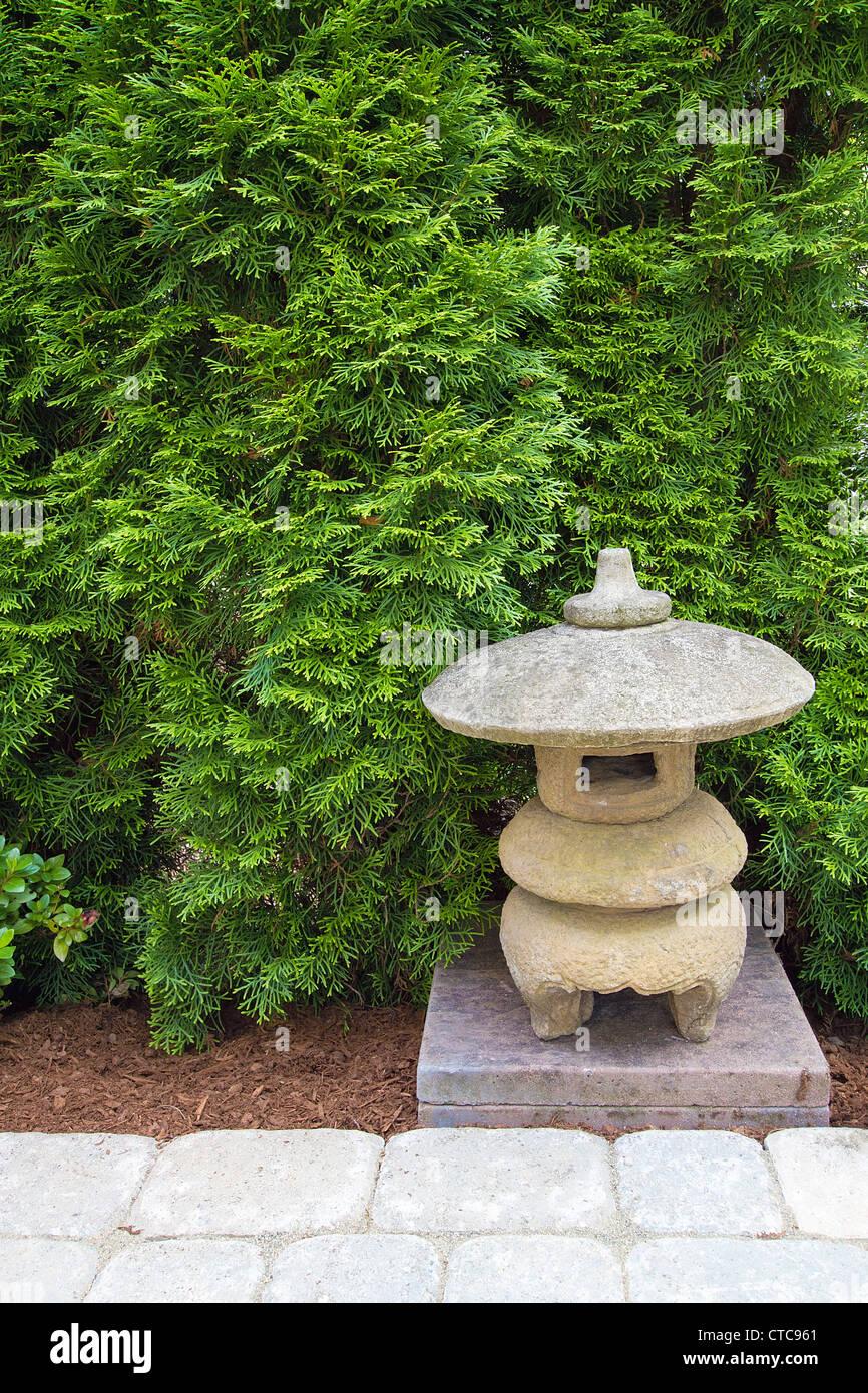 Japanese stone pagoda in backyard garden paver patio stock for Garden pagodas designs