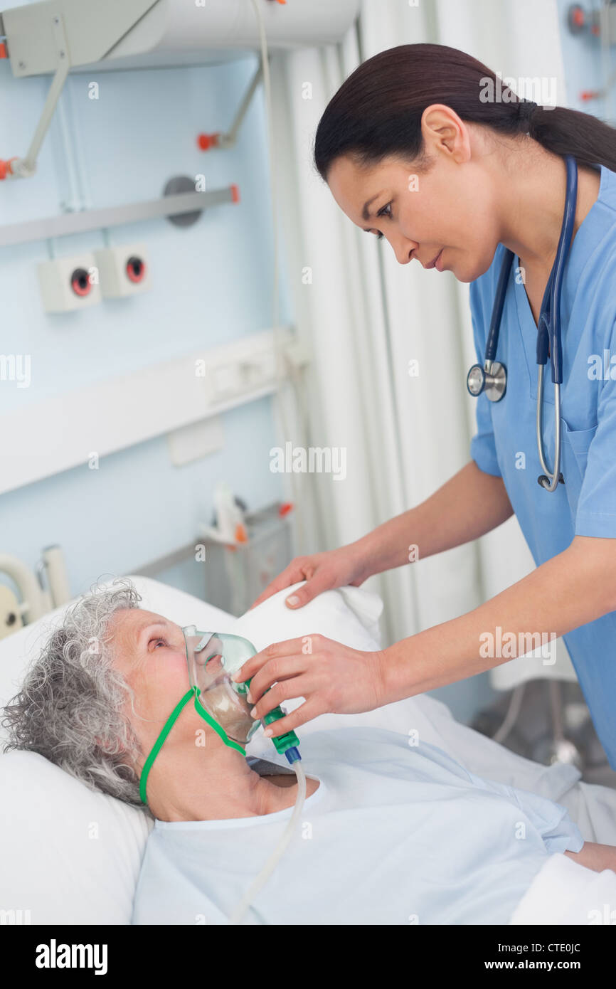 High angle view of patient wearing oxygen mask while