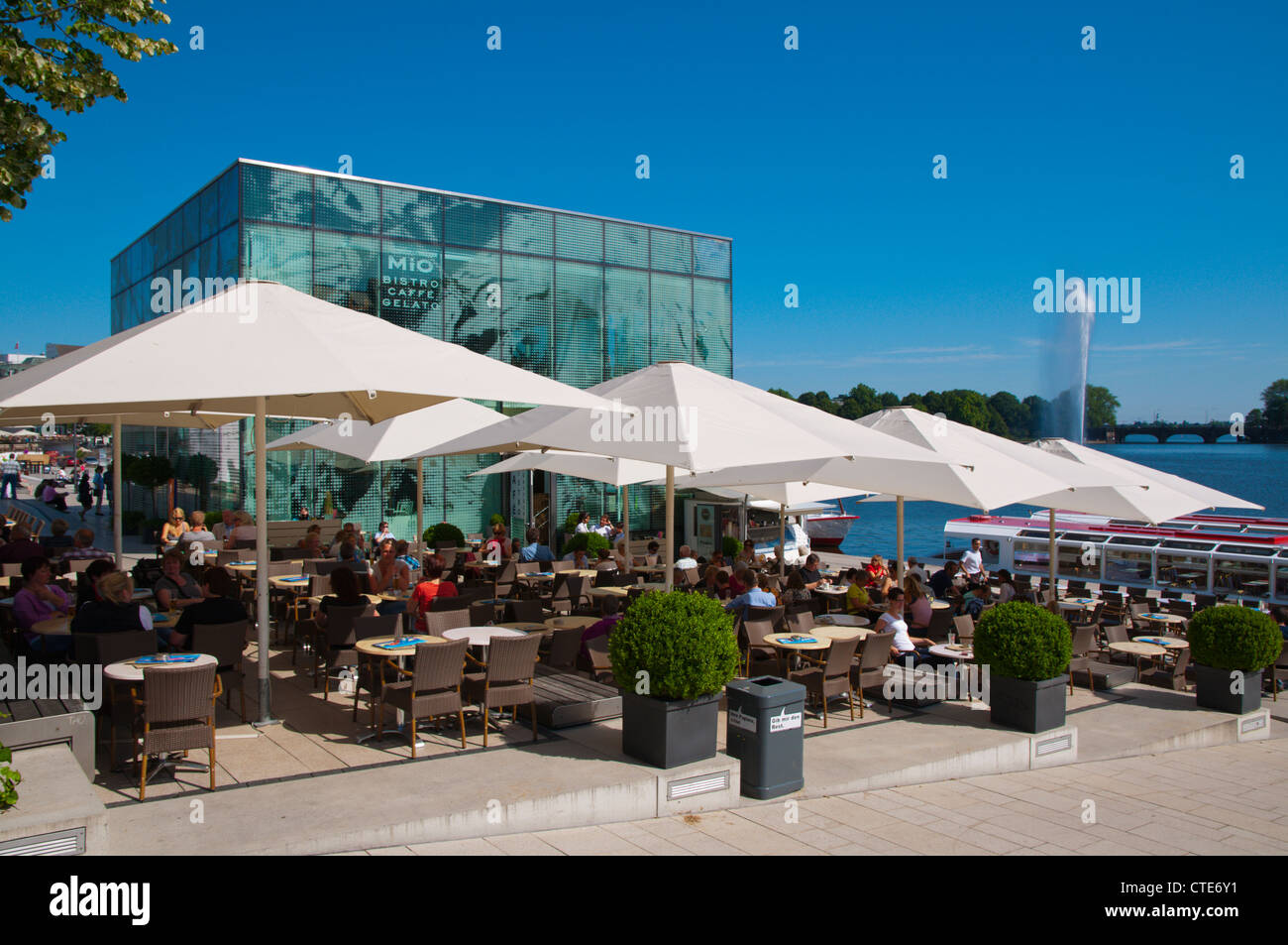 restaurant cafe terrace outside ice cube building binnenalster stock photo royalty free image. Black Bedroom Furniture Sets. Home Design Ideas