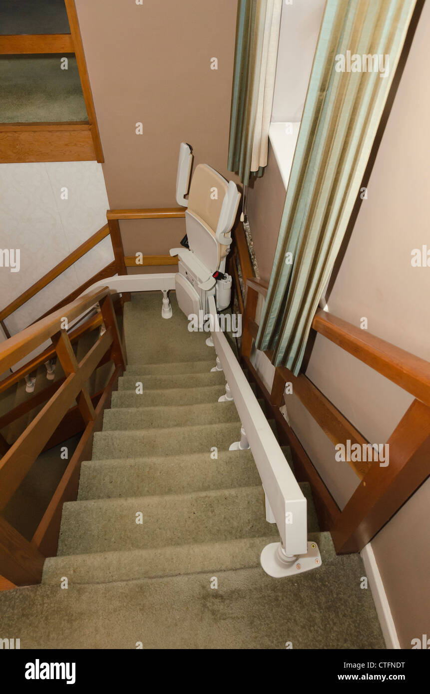 a stationary electric acorn stair lift fitted to a staircase an electrical disabled persons device to convey them upstairs - Lift Up Stairs