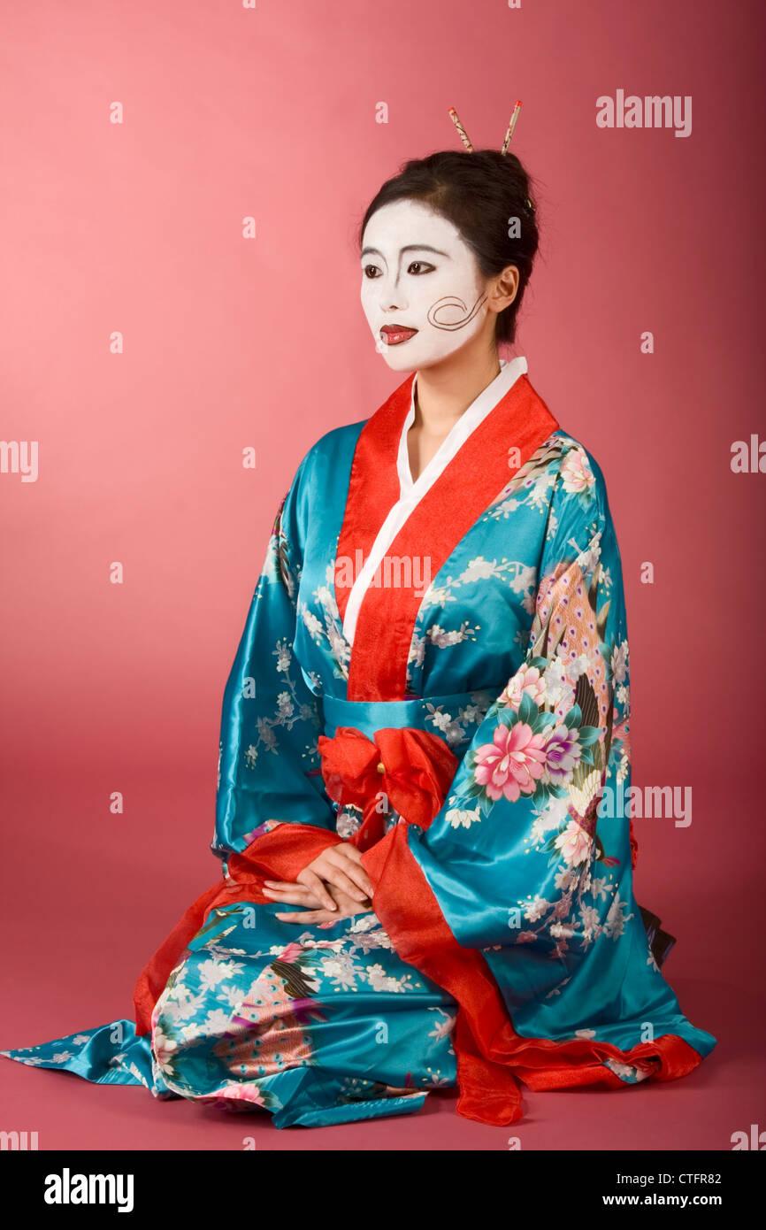Asian Female With Geisha Style Face Paint In Yukata