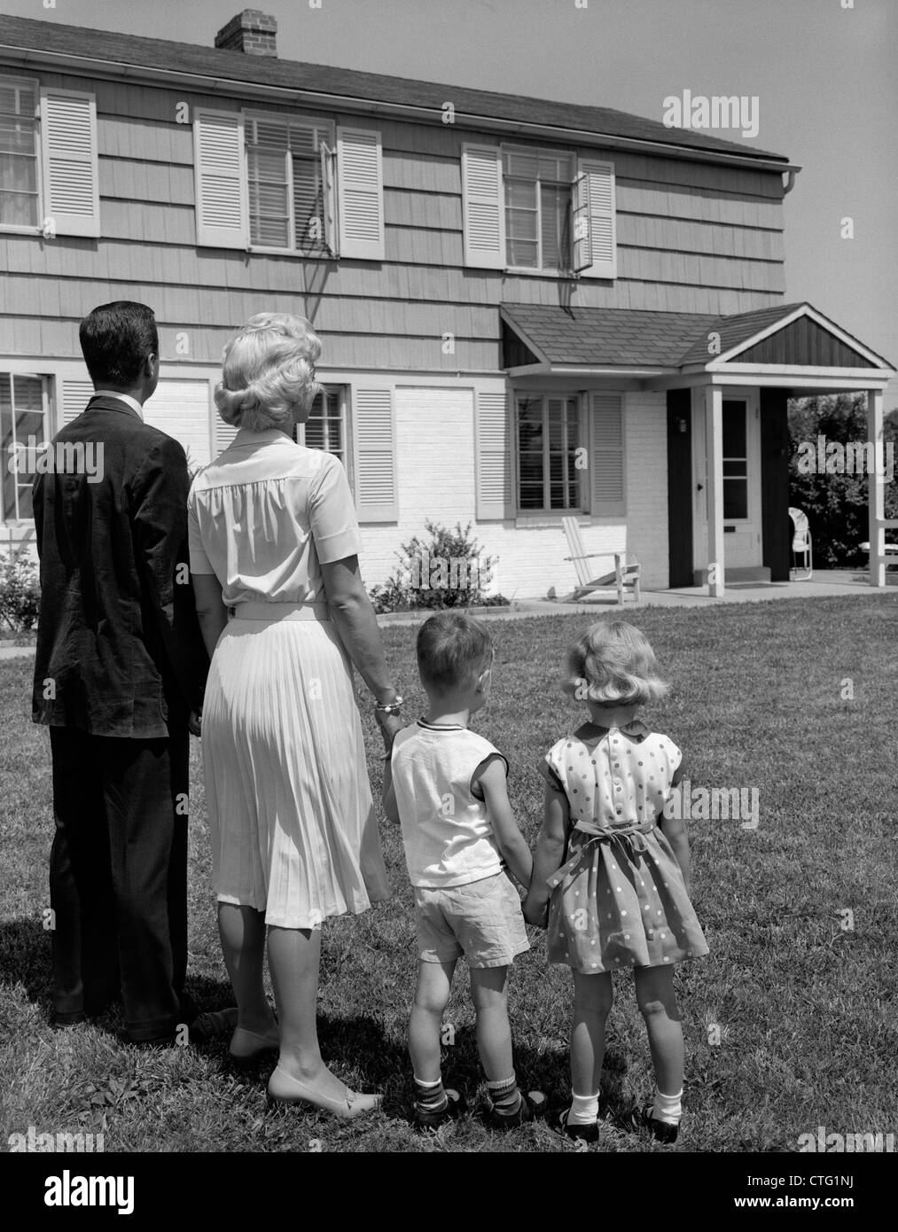 1950s House 1950s 1960s family father mother son daughter standing together