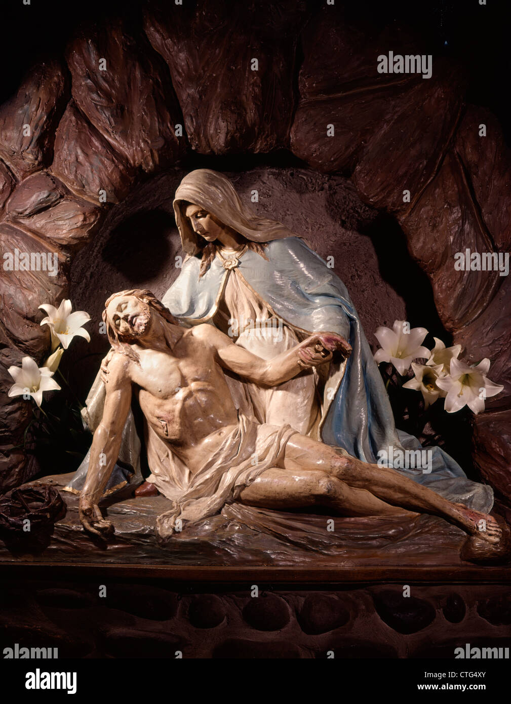 a pieta statue of mary mother holding dead body of jesus christ in