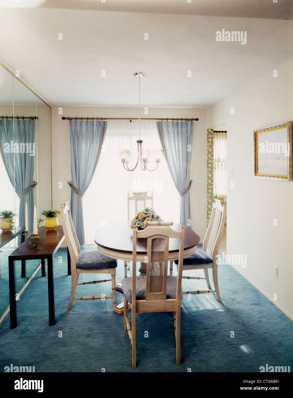1970s retro dining room pale blue drapes carpeting dining table four pale blue white chairs chandelier mirror wall - Carpeted Dining Room