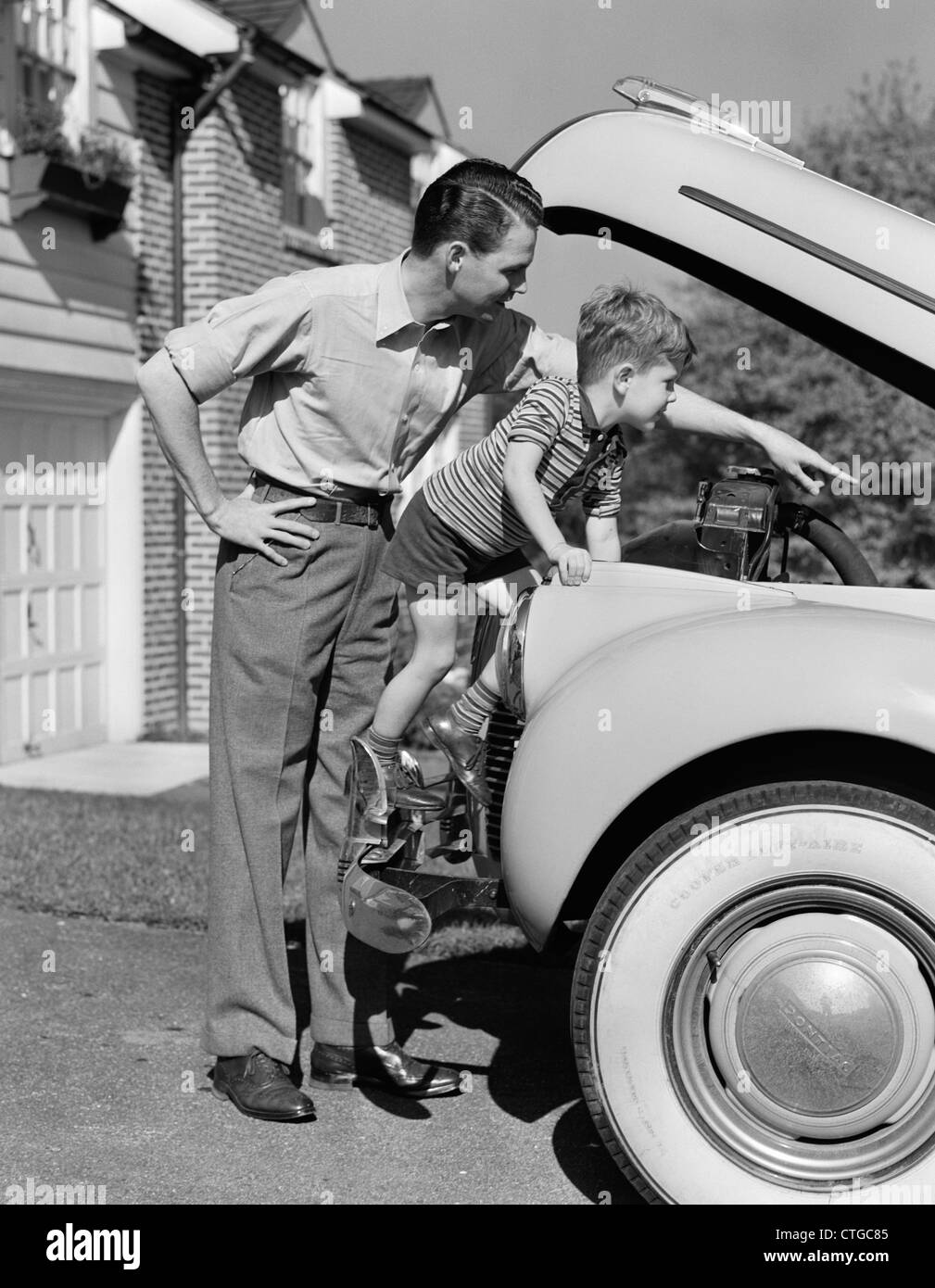 Old Fashioned Cars >> 1940s FATHER & SON CHECKING UNDER HOOD OF CAR IN DRIVEWAY Stock Photo, Royalty Free Image ...