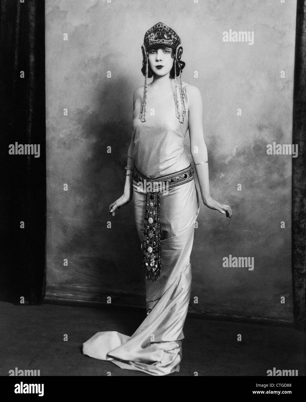 Egyptian inspired modern day style - 1920s Woman Wearing Exotic Egyptian Inspired Lame Gown Costume With Jeweled Belt Headpiece Fashion