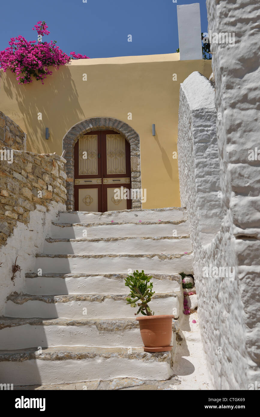 A Nice Home In The Village Of Chorio With Whitewashed Stairs, Walls And  Bougainvillea; Symi, Dodecanese. Greece