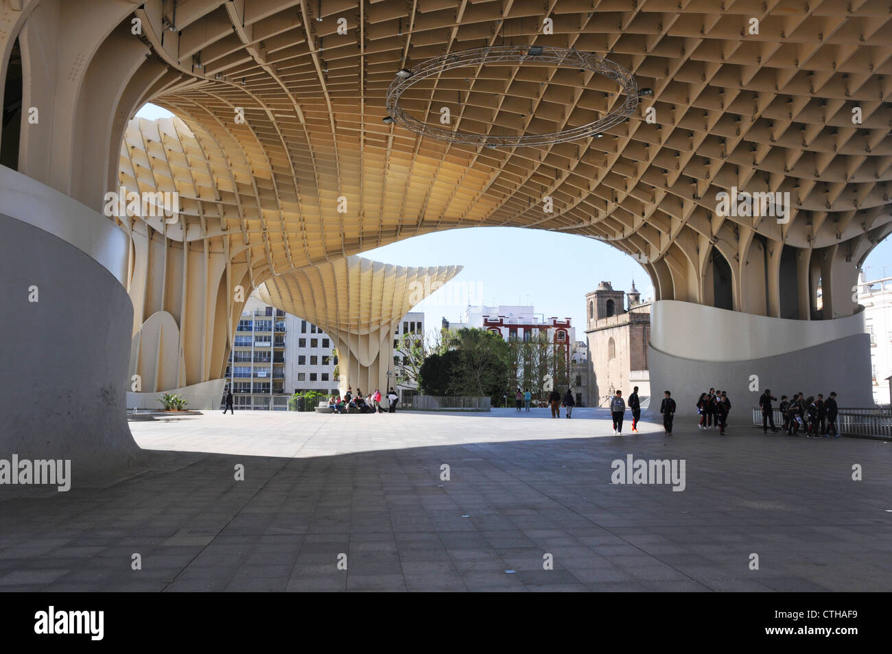 People Under Modern Architectural Roof Structure In Plaza De La  Encarnacion, Seville, Spain.