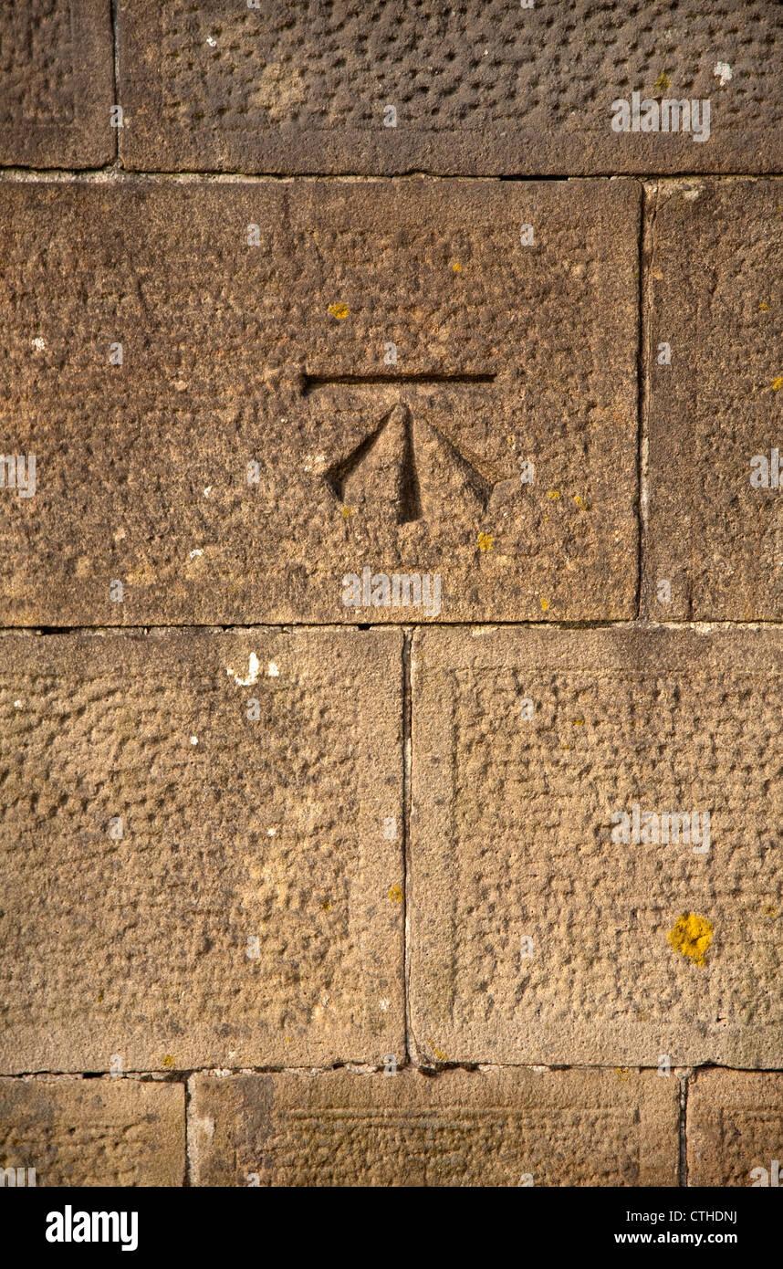 Ordnance survey surveyors benchmark carved in stone on a