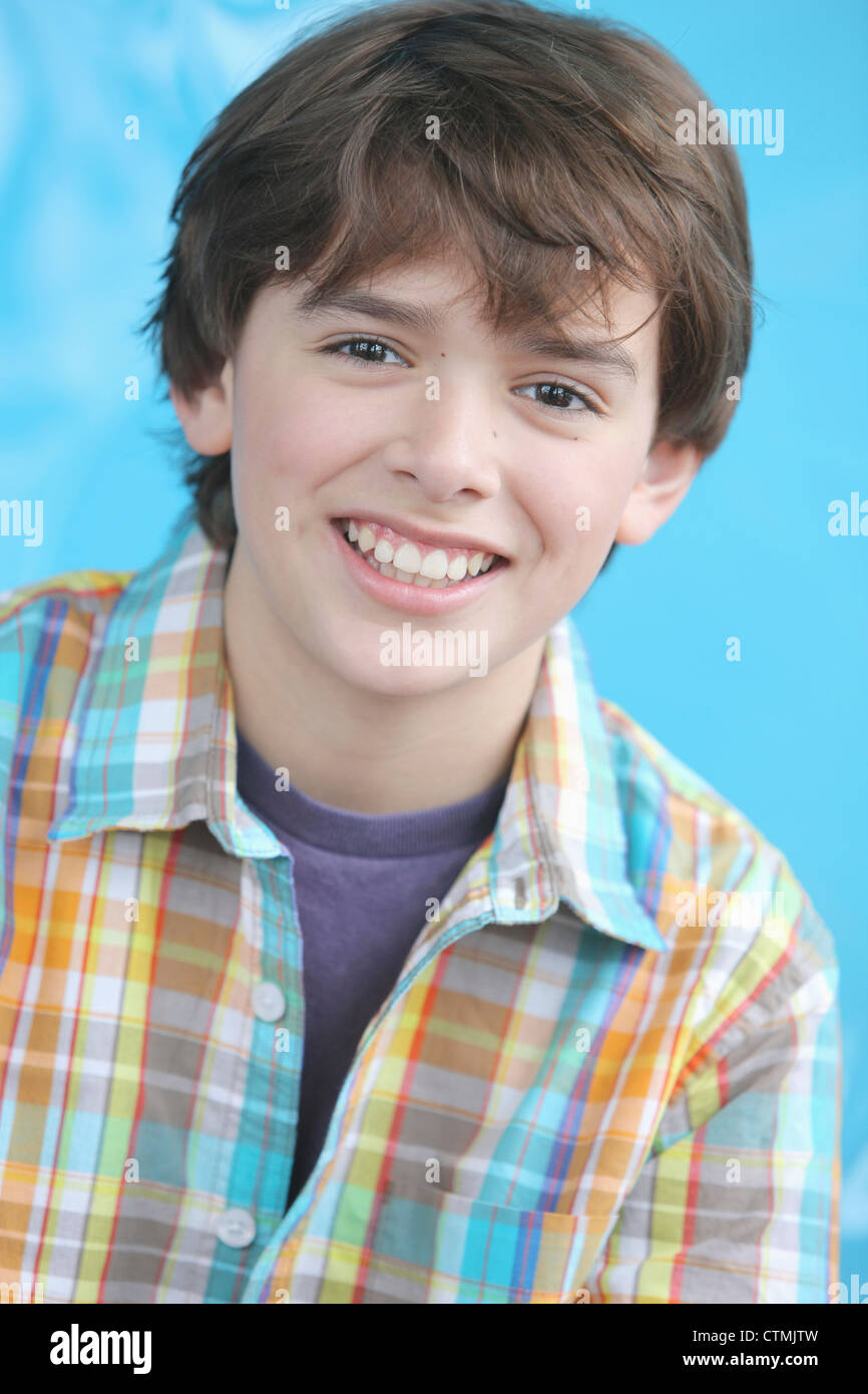 Portrait Of A Boy With Brown Hair And Brown Eyes Wearing A ...