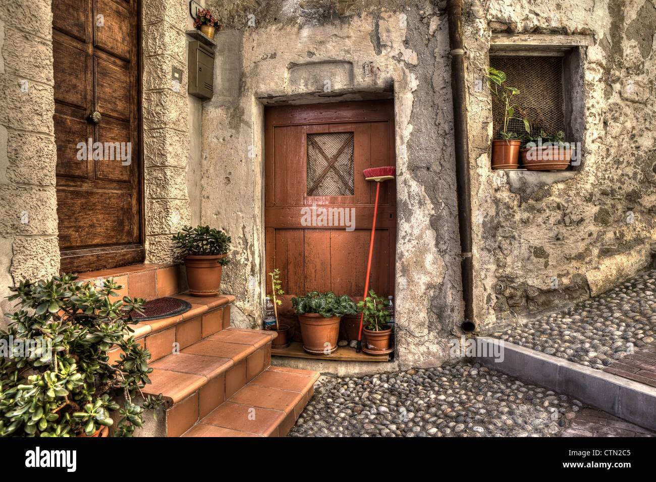 Vintage wooden doors, old house and cobbled narrow street in town ...