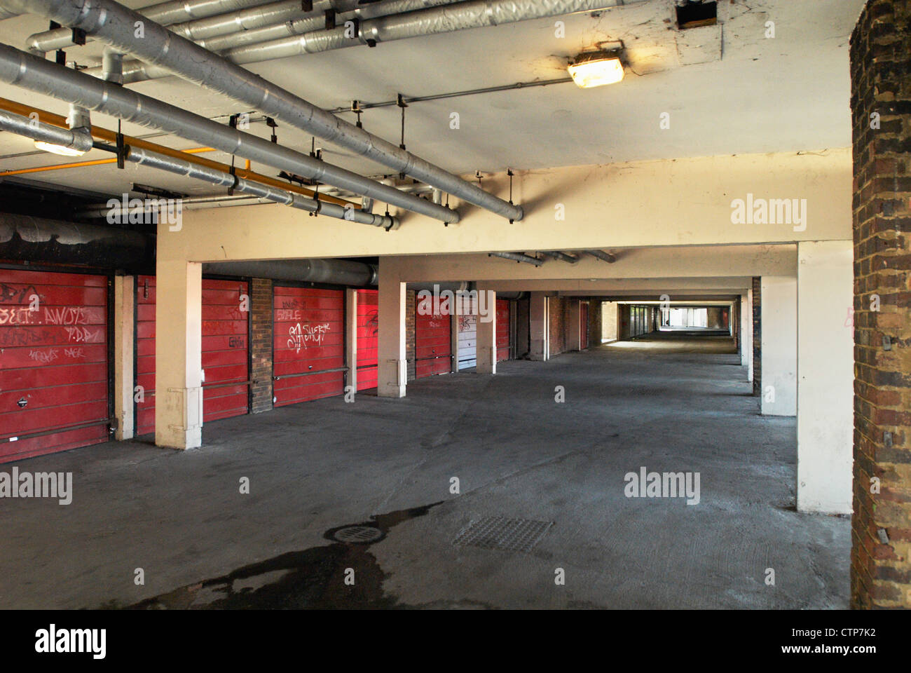 Underground garages and utility pipes under apartment block, South East  London, UK