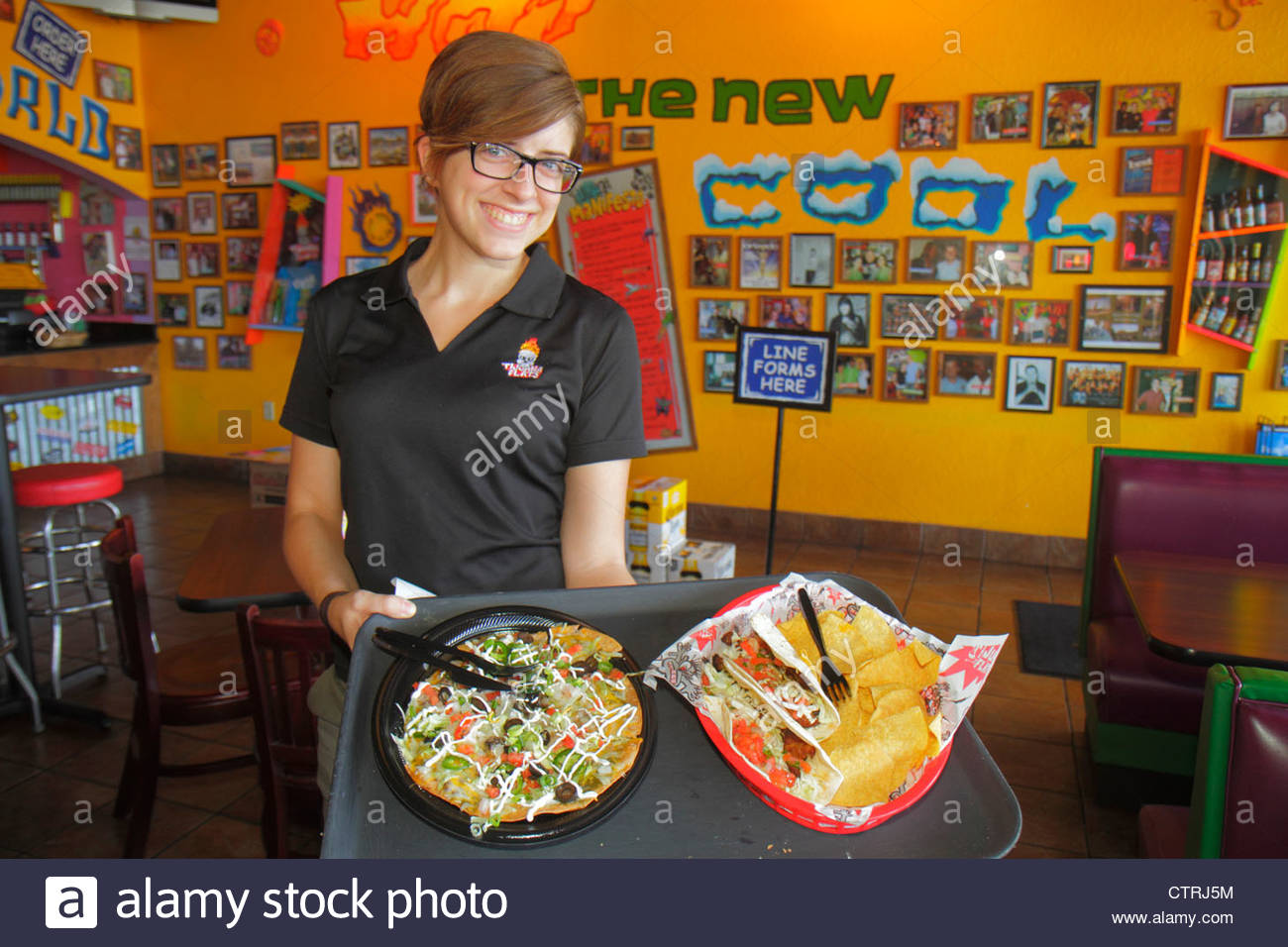Mexican Restaurant Decor mexican restaurant waitress stock photos & mexican restaurant