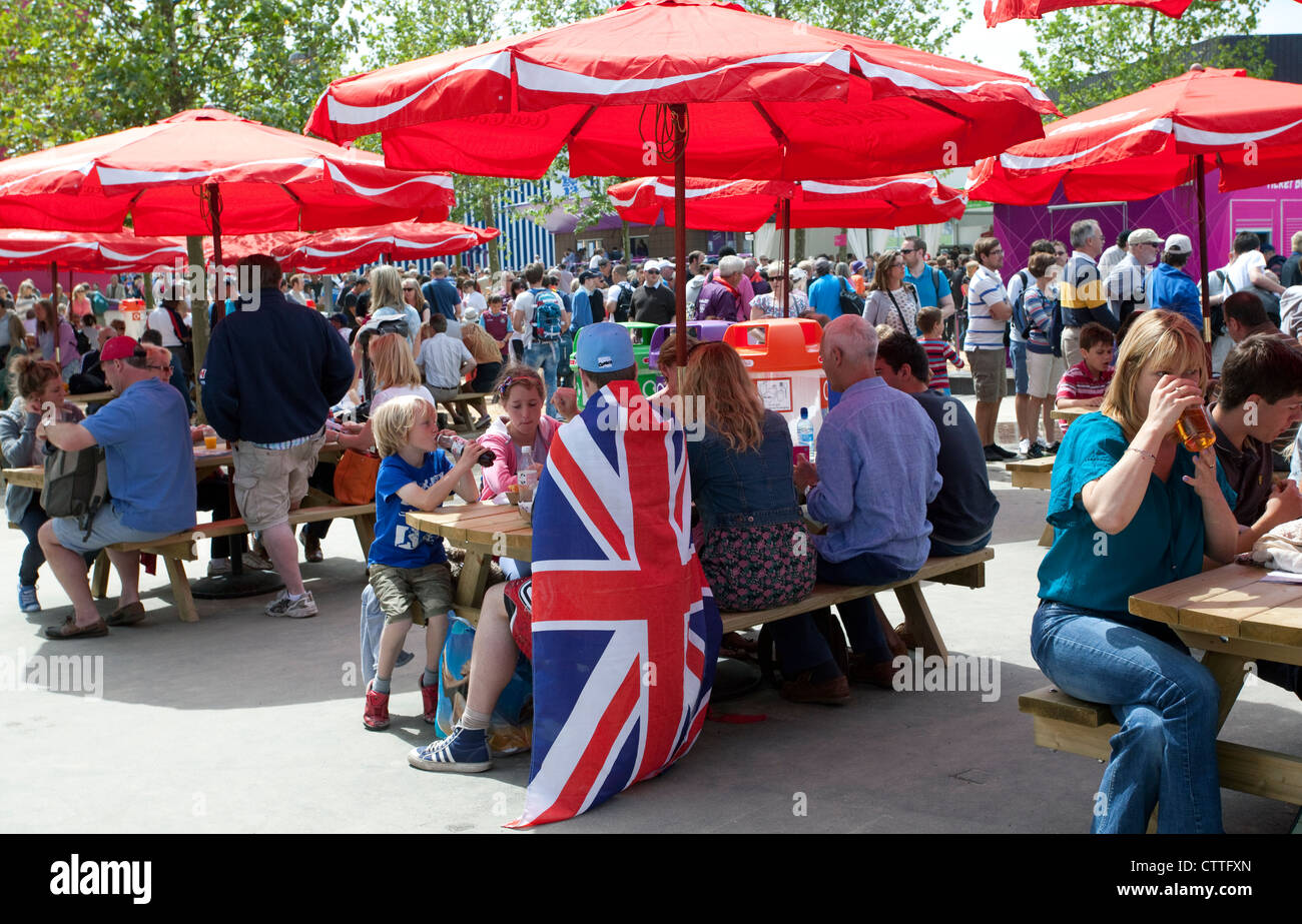 Fan Draped With Union Jack Flag In Picnic Area Olympic Park London
