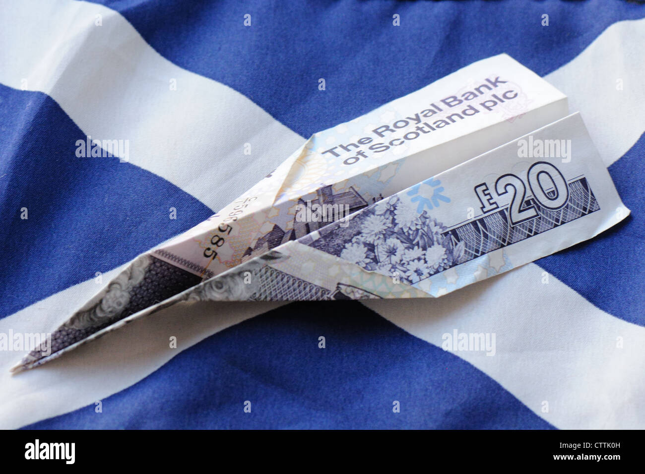 royal bank of scotland 20 pound note folded to make paper plane on
