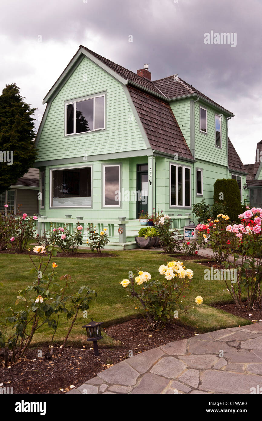 gambrel stock photos gambrel stock images alamy old pale green painted wooden house with gambrel roof beautiful lawn with rose garden on
