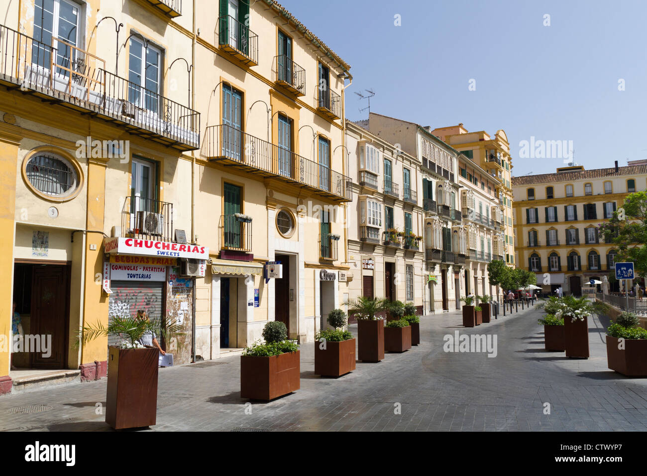 small shops below apartments in the malaga old town spain stock