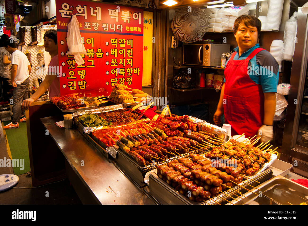 Street food stalls selling various foods and snacks in the ...