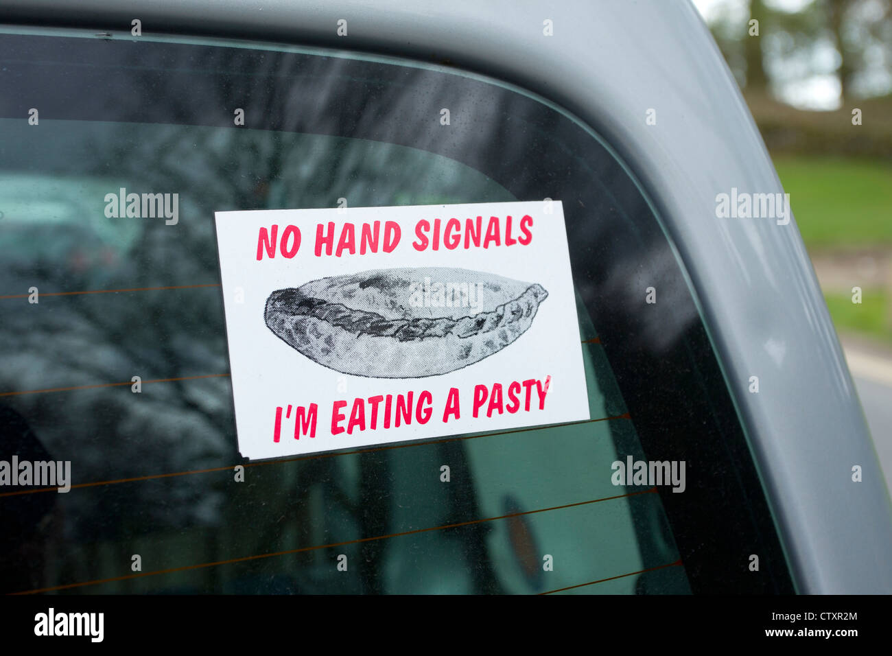 No Hand Signals Im Eating A Pasty Sign On Car Stock Photo - Car signals