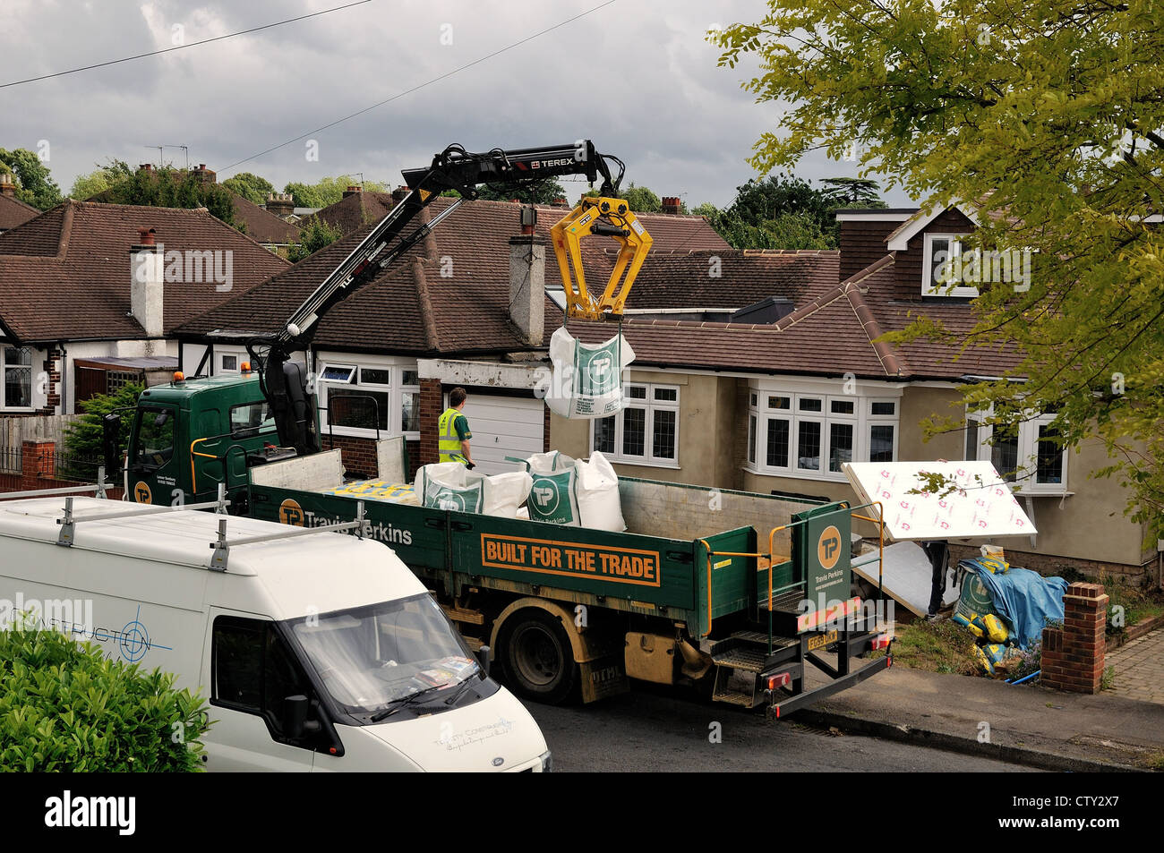 Builders merchant stock photos builders merchant stock images travis perkins lorry delivering building materials stock image baanklon Choice Image