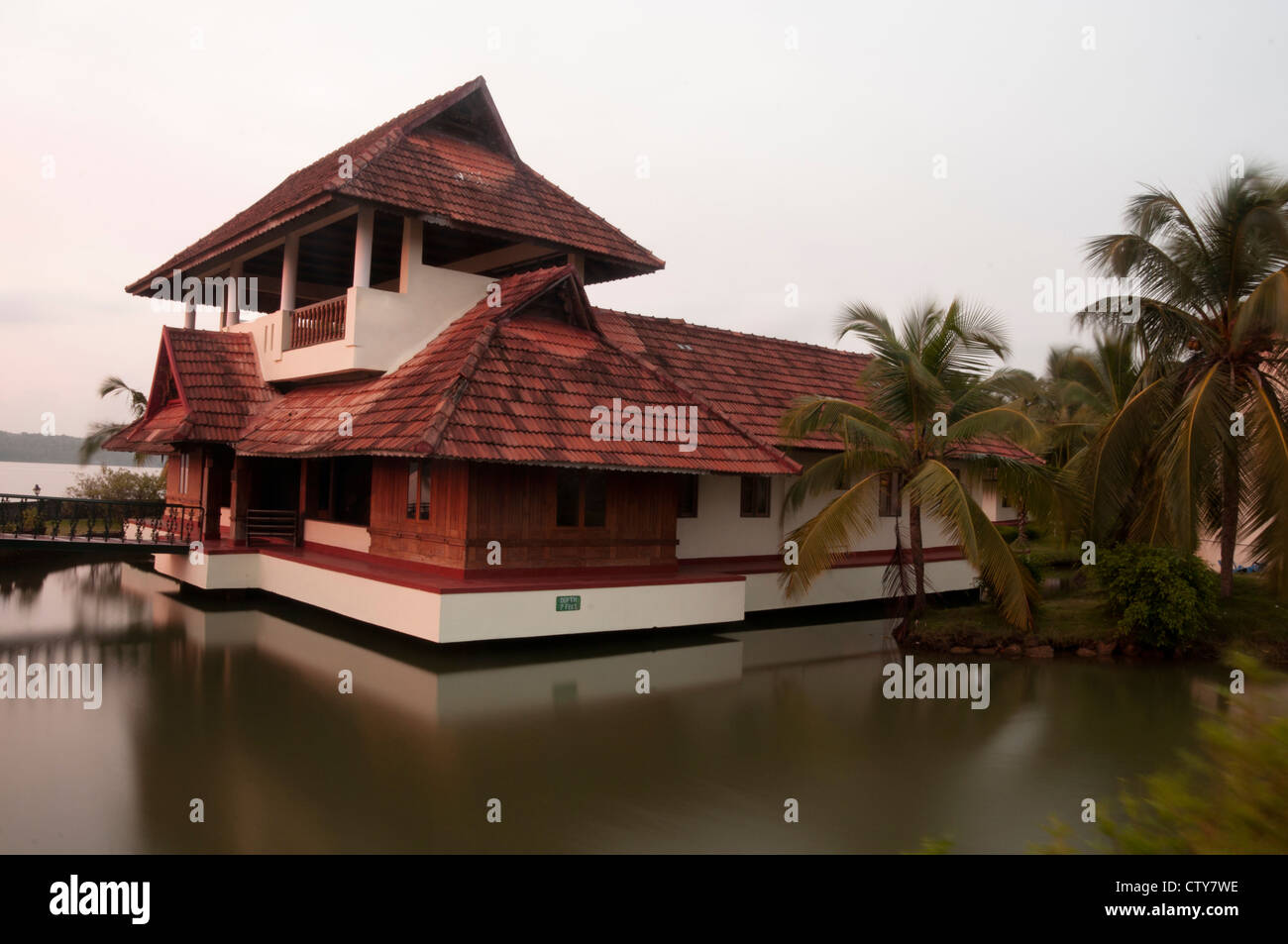 Tiled Roof House Surrounded By Water In Kerala South