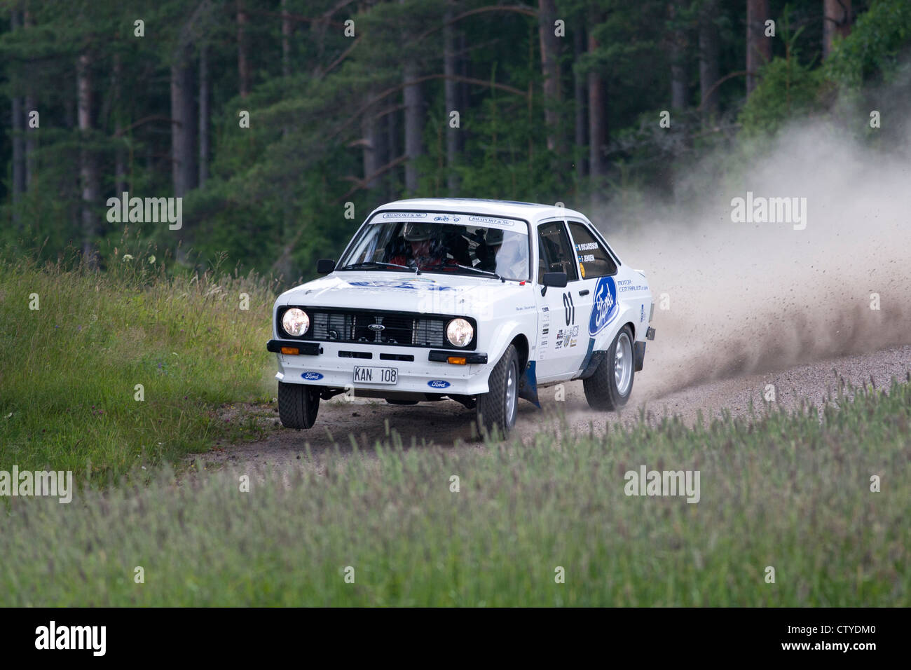 Old rally car on gravel road Stock Photo, Royalty Free Image ...