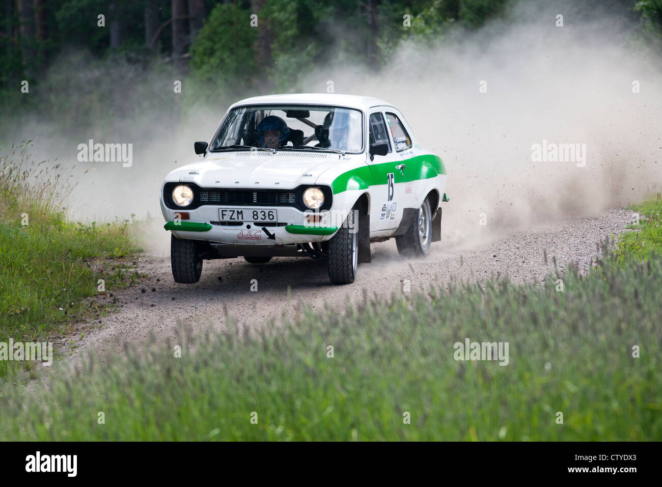 Old rally car on gravel road Stock Photo: 49776107 - Alamy