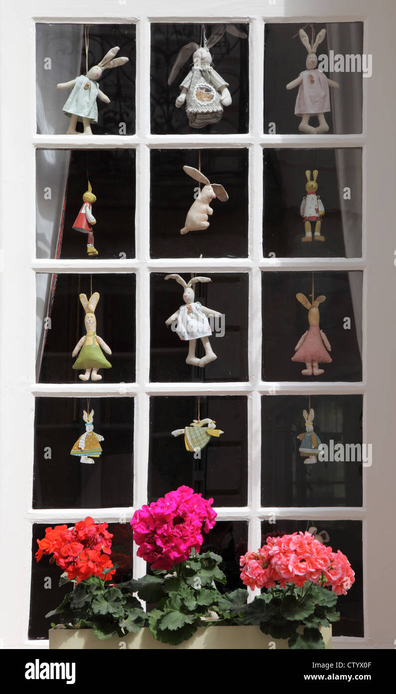 small-paned-window-with-rabbit-dolls-at-