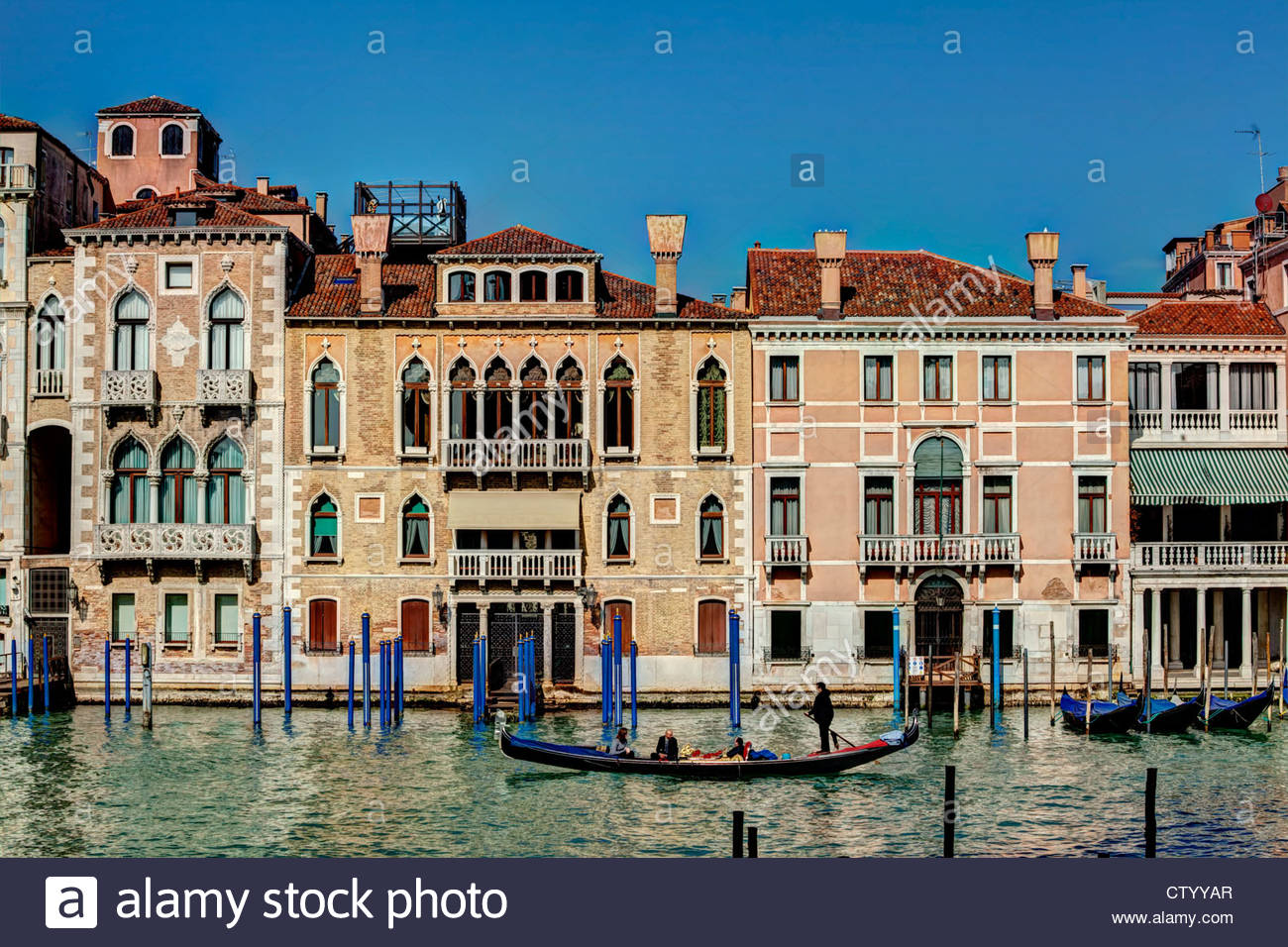 A Gondola Glides Past Beautiful Venetian Buildings On The Grand Canal,  Venice, Italy