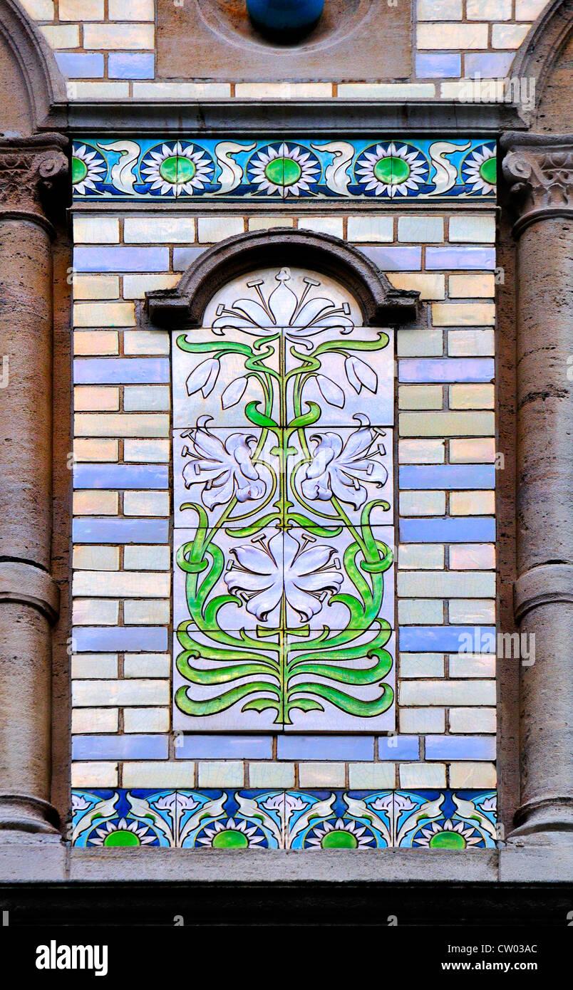 Brussels belgium art nouveau detail ceramic tiles by privat art nouveau detail ceramic tiles by privat livemont on facade of anciennne grande maison de blanc dailygadgetfo Gallery