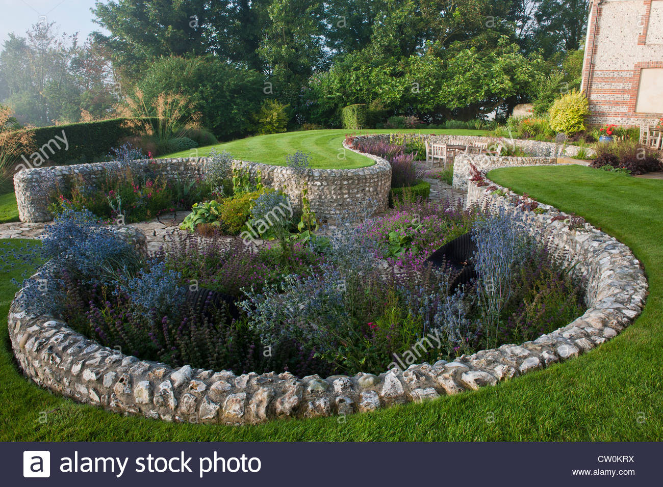 Contemporary sunken garden stone walls retaining designer for Circular lawn garden designs