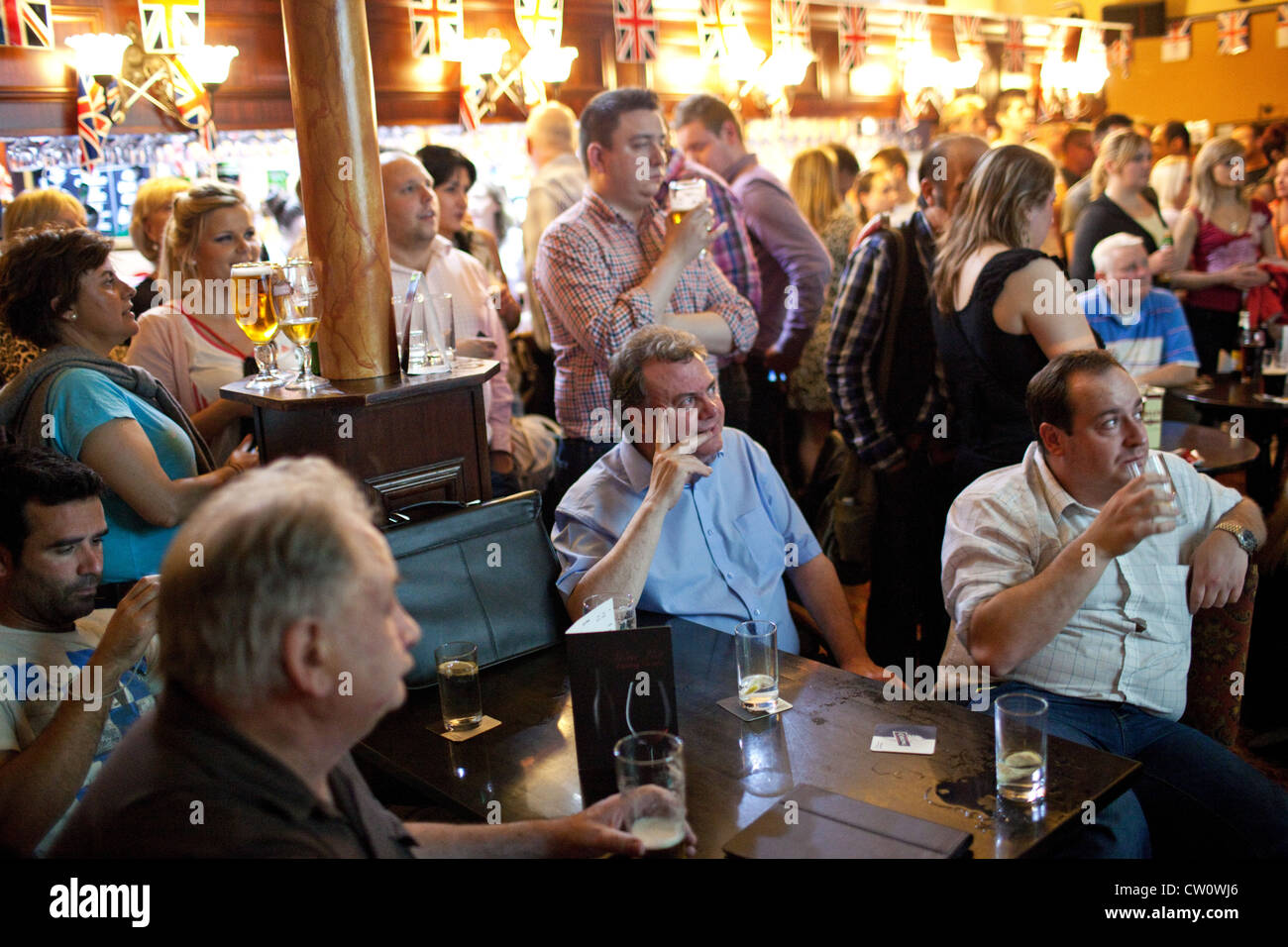 People Watch The London 2012 Olympics Opening Ceremony In A Pub Outside Olympic Park Stratford UK