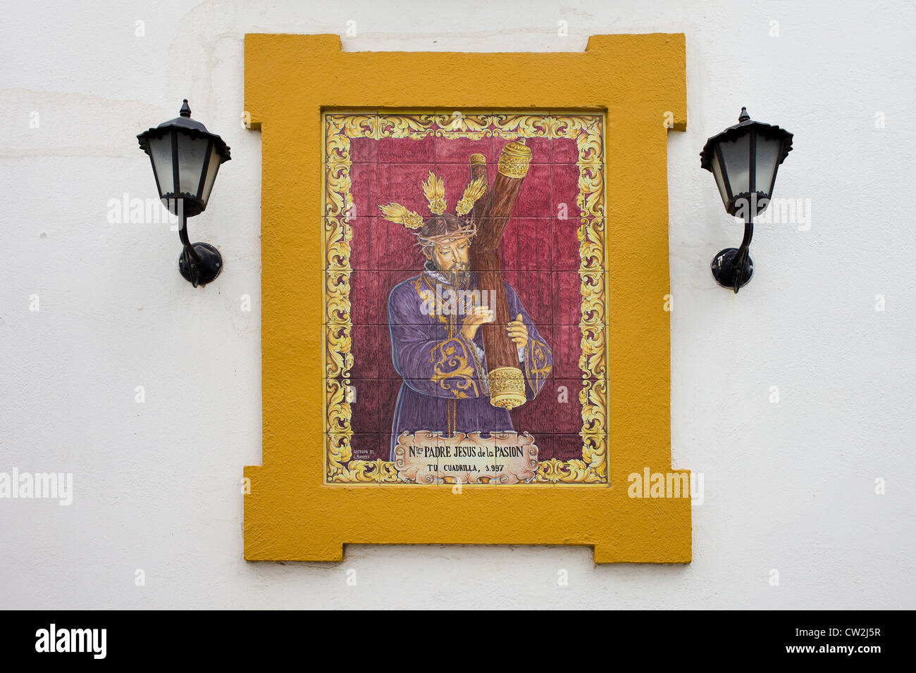 Jesus chris carrying the cross an azulejo style ceramic tilework on jesus chris carrying the cross an azulejo style ceramic tilework on a wall of a house in old jewish quarter cordoba spain dailygadgetfo Images