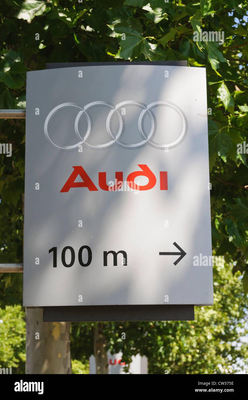 Audi Car Maker Company Logo On A Street Sign Showing The Way - Audi car maker