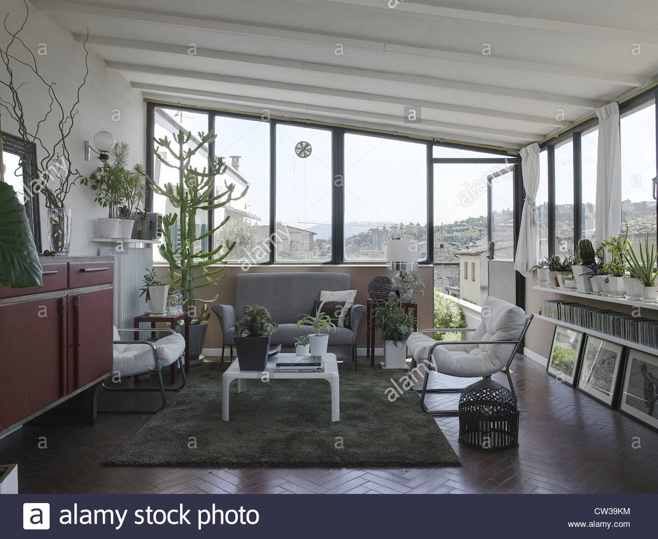 Modern living room in a apartment in italy with many for Modern living room plants