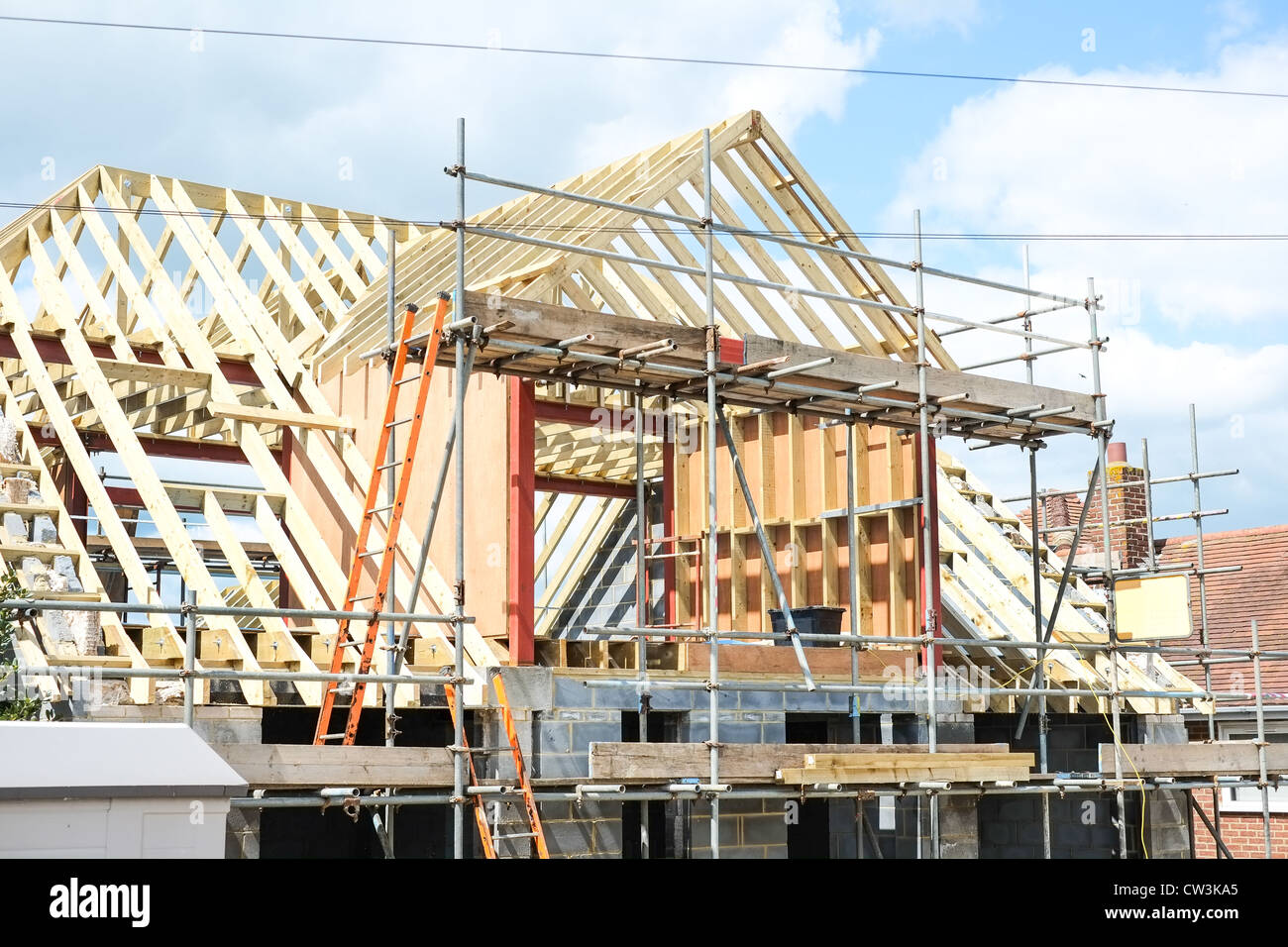 Building a dormer on a house - New House Under Construction With A Large Dormer Roof