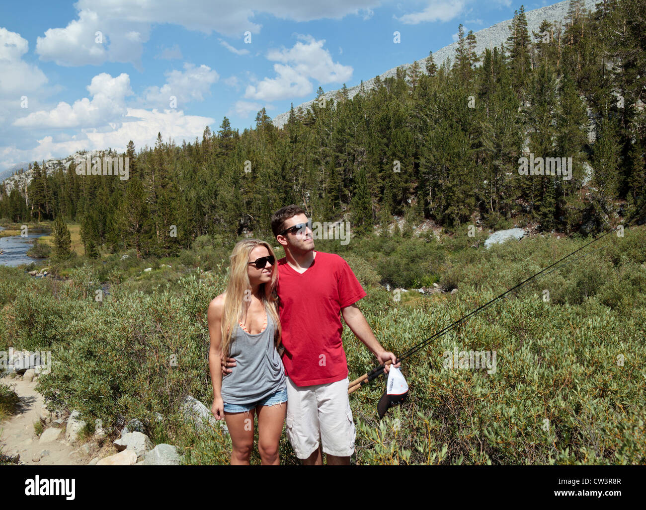 Couple on the trail to little lakes valley in rock creek for Canyon lake fishing ca