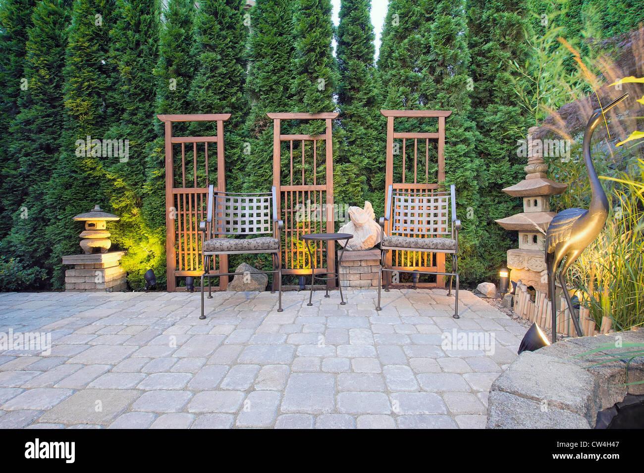 Garden paver patio with trellis japanese stone lantern for Garden pagodas designs