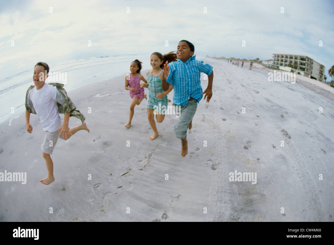 Two Boys And Girls Running On The Beach