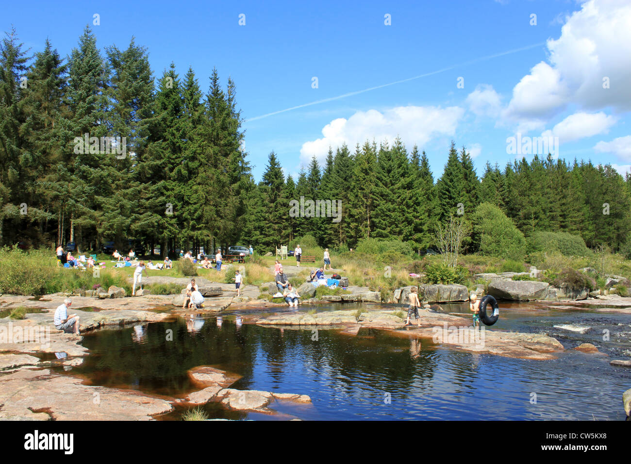 People picnicing by the otter pool on the river dee in the - Swimming pools in dumfries and galloway ...
