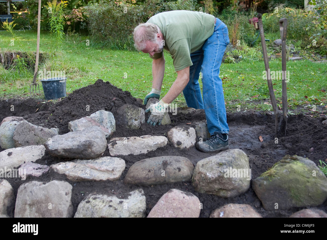 building a rockery for herbs in the garden germany stock. Black Bedroom Furniture Sets. Home Design Ideas