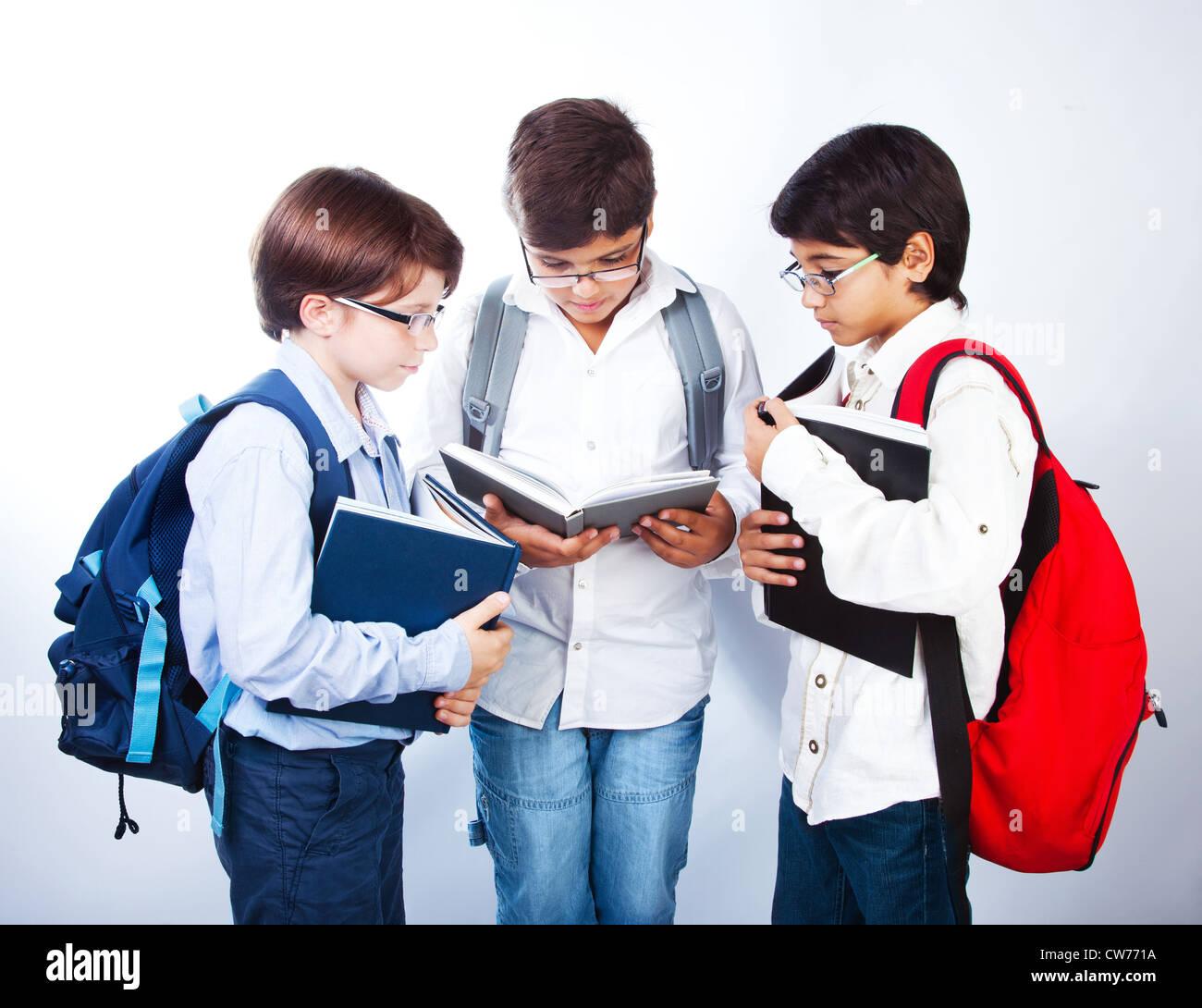 three smart boys read books classmates make homework schoolboys