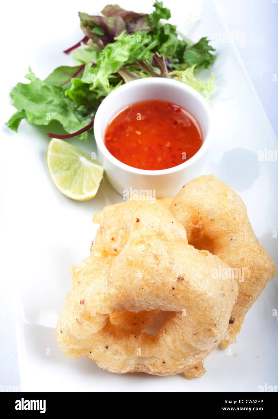 Fried Calamari With Dipping Sauce And Salad Stock Photo