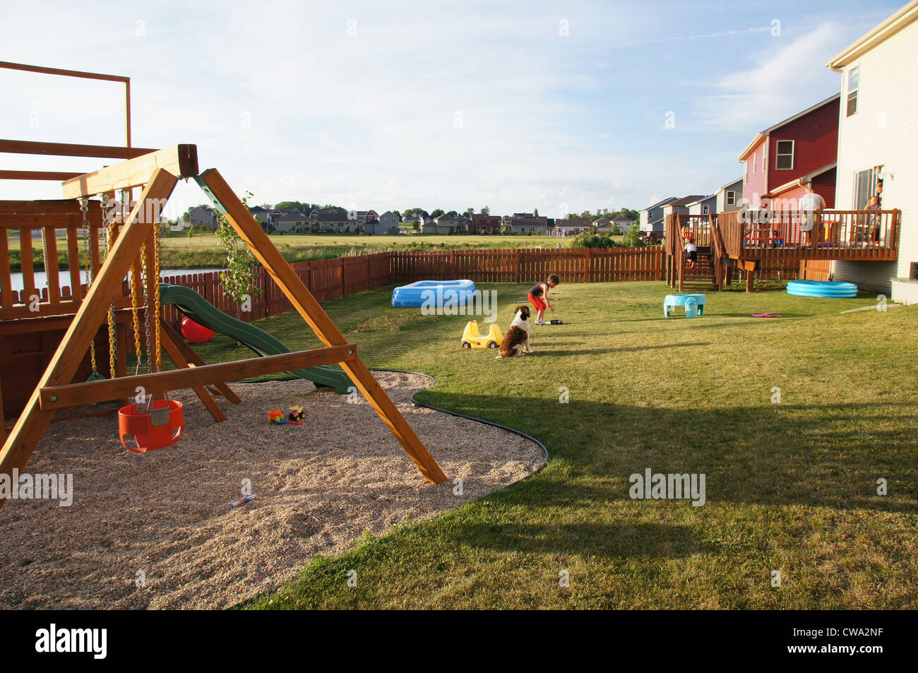 Backyard Playground Kids Dogs Urban Suburb Swing Barbeque Pool Grass Lawn  Mowed Pristine Clean Plymouth