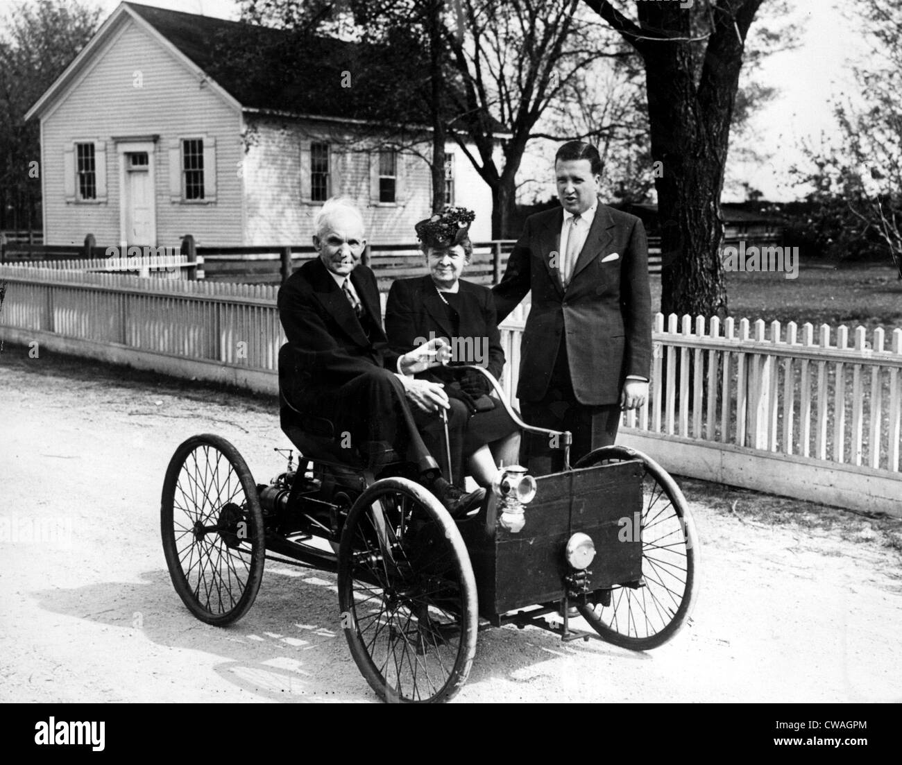 Henry Ford in his first automobile dated 1896. With him, wife ...