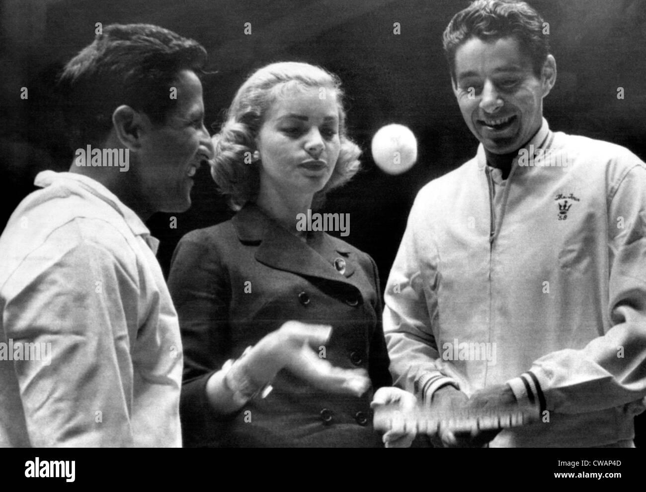 Actress Lauren Bacall serves up ball to pro tennis king Pancho