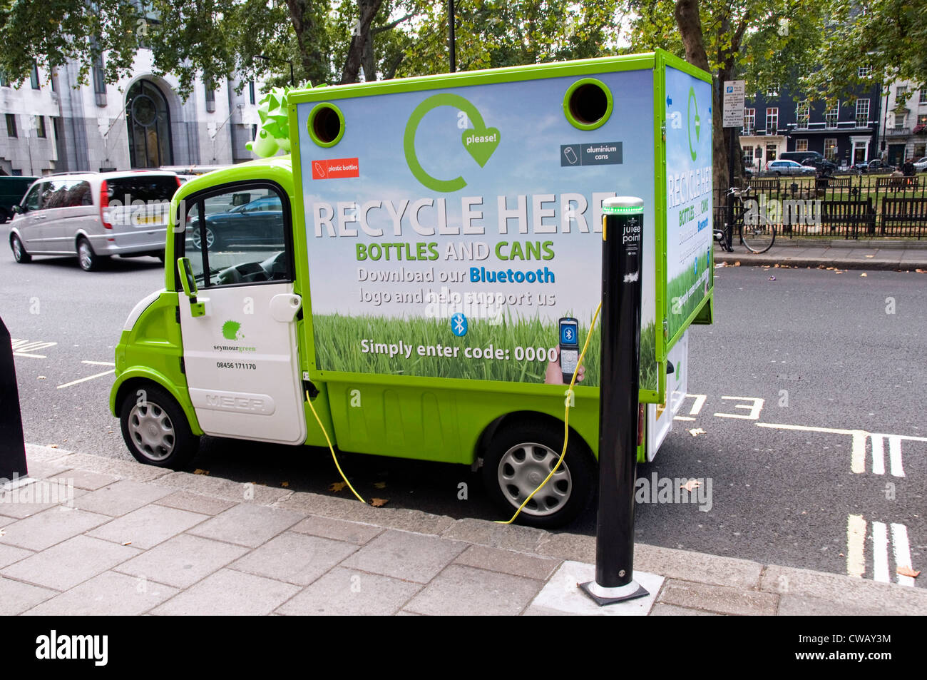 Seymour green mobile electric recycling van for bottles and cans in stock photo royalty free - Recycling mobel ...